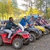 FIVE AUTUMN ATV RIDERS GETTING READY TO RIDE