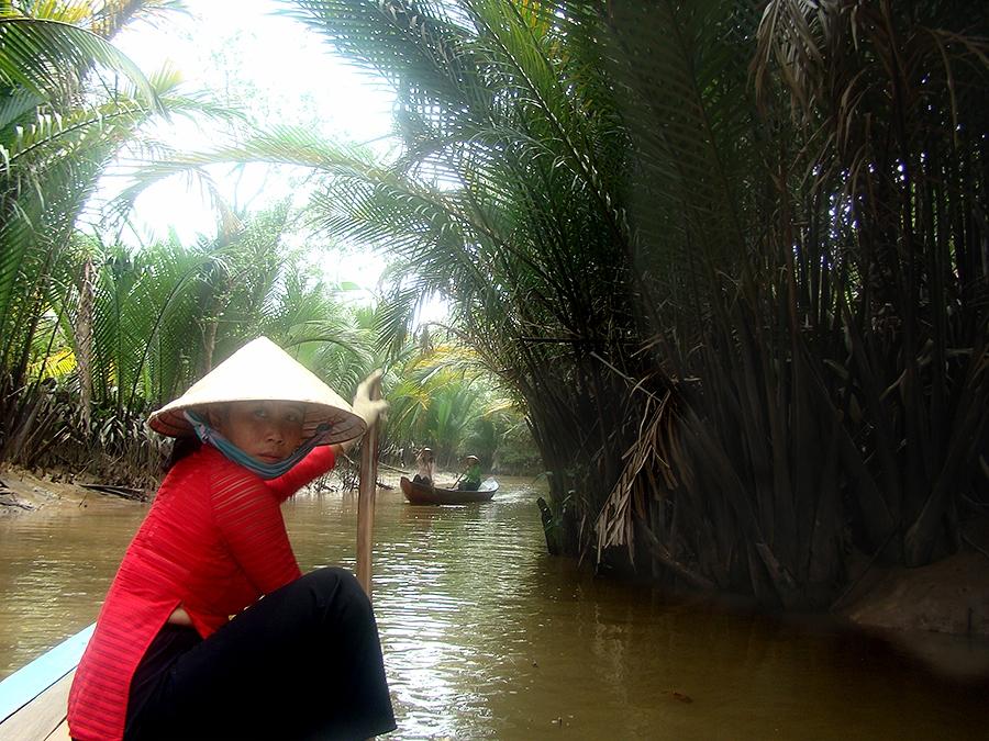 Travel with Sara Raney. (Photo taken in Mekong Delta, Vietnam.)